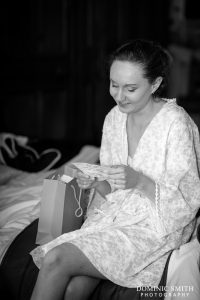 Hazel receiving a gift from her Husband-to-be