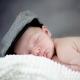 Newborn baby wearing a flat cap
