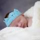 Newborn wearing a crown