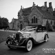 Classic wedding car leaving Wakehurst Place