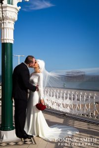 Bridal photo taken at the Bandstand on Brighton Seafront with the West Pier in the background