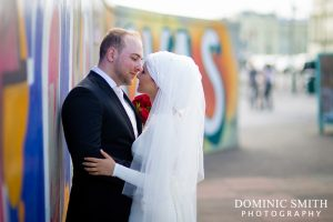 Bridal photo taken on Brighton Seafront with the graffiti in the background