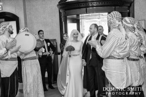 Bride and Groom arrive at the Hilton Hotel