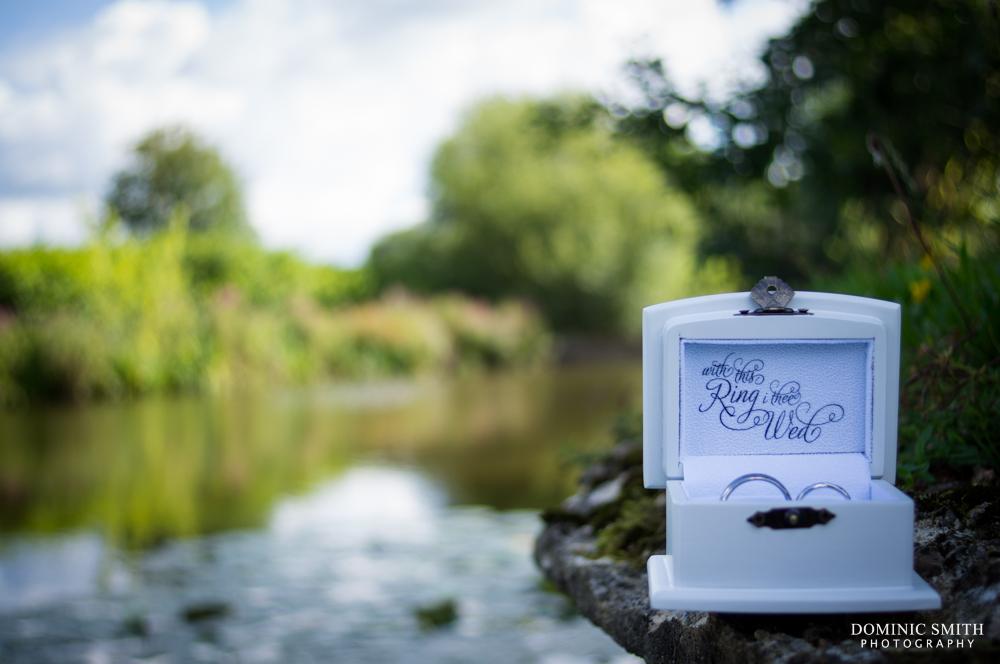 Wedding rings taken at the Gatton Manor Lake