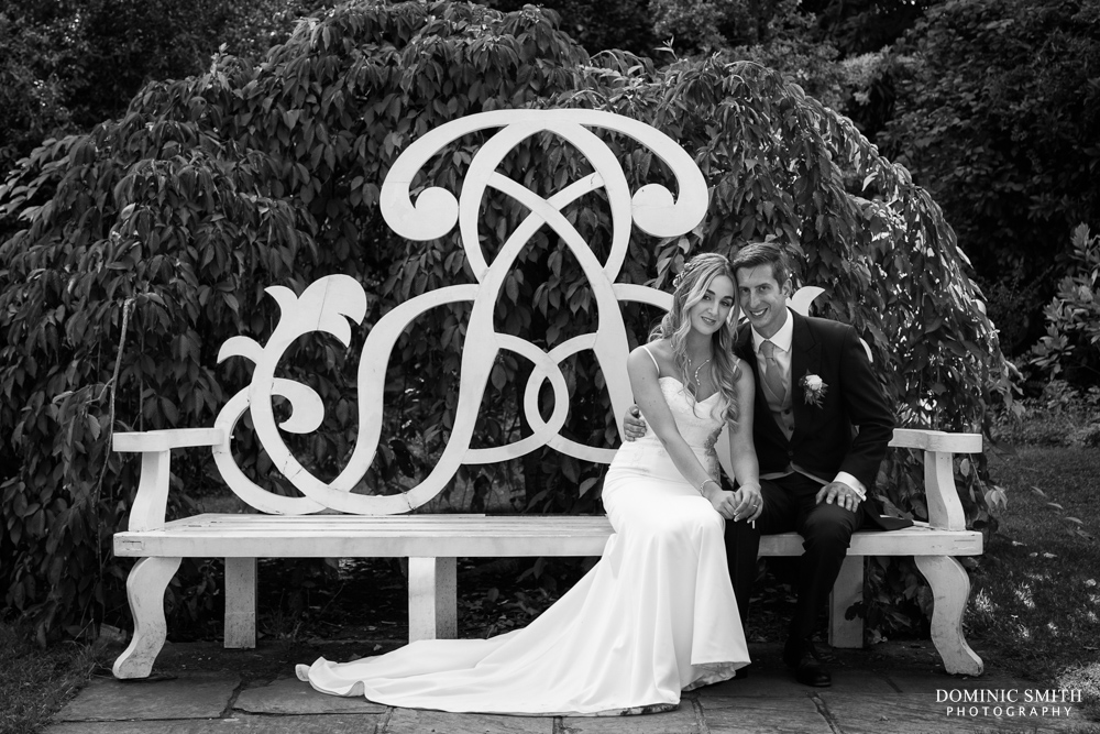 Wedding photo taken on the bench at Nymans