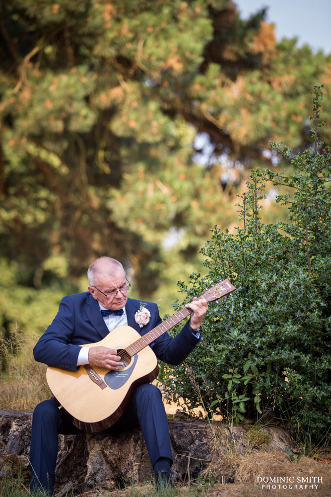 Father of the Groom playing guitar at Coulsdon Manor