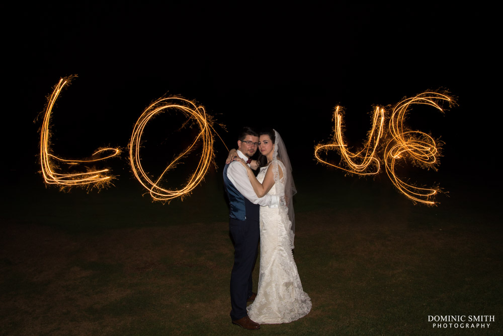LOVE Sparkler photo taken at Coulsdon Manor Wedding