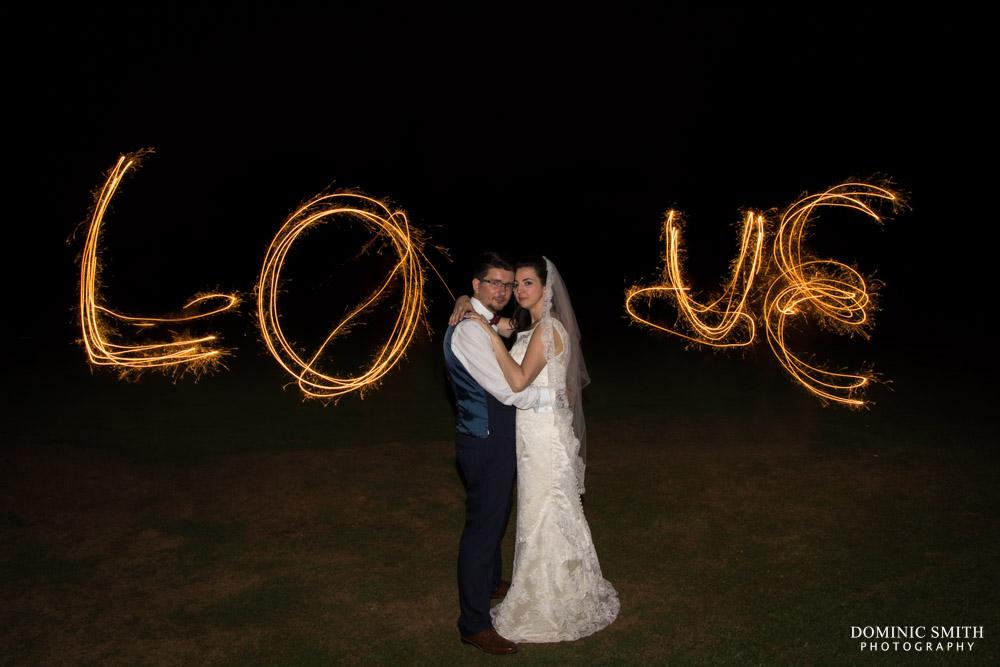 LOVE Sparkler photo taken at Coulsdon Manor Wedding