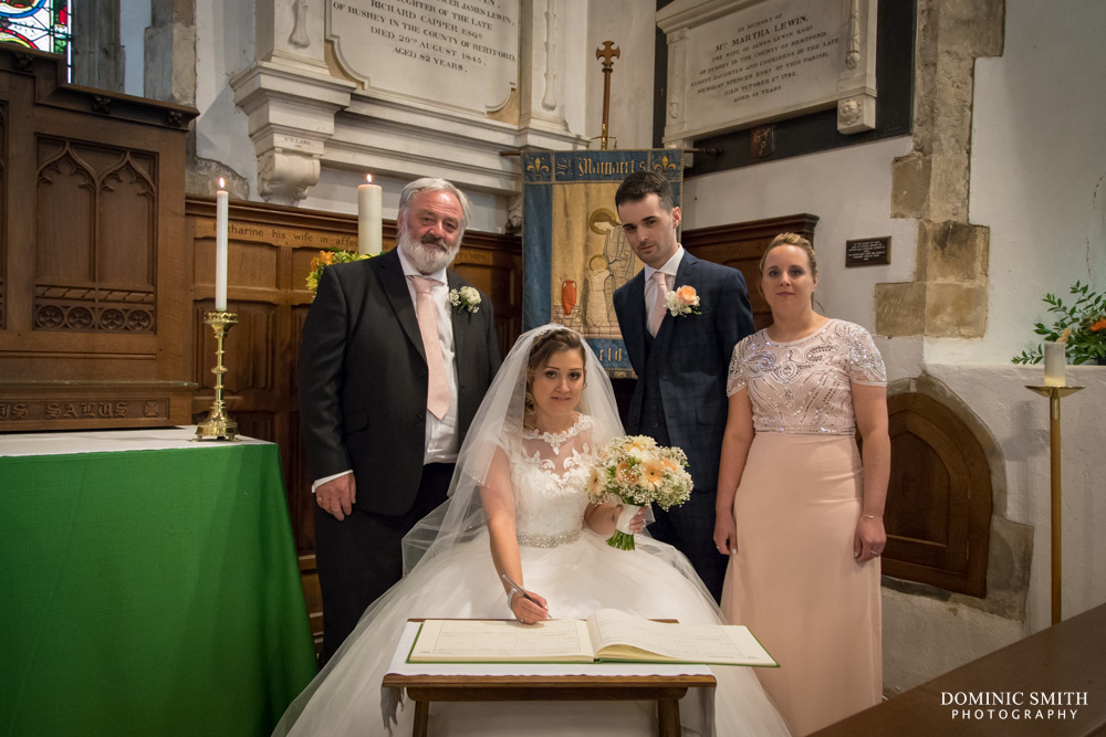 Signing the register at St Margarets Church Ifield