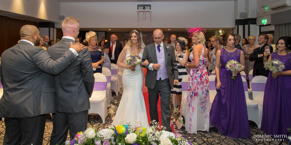 Walking down the aisle at Crowne Plaza Felbridge
