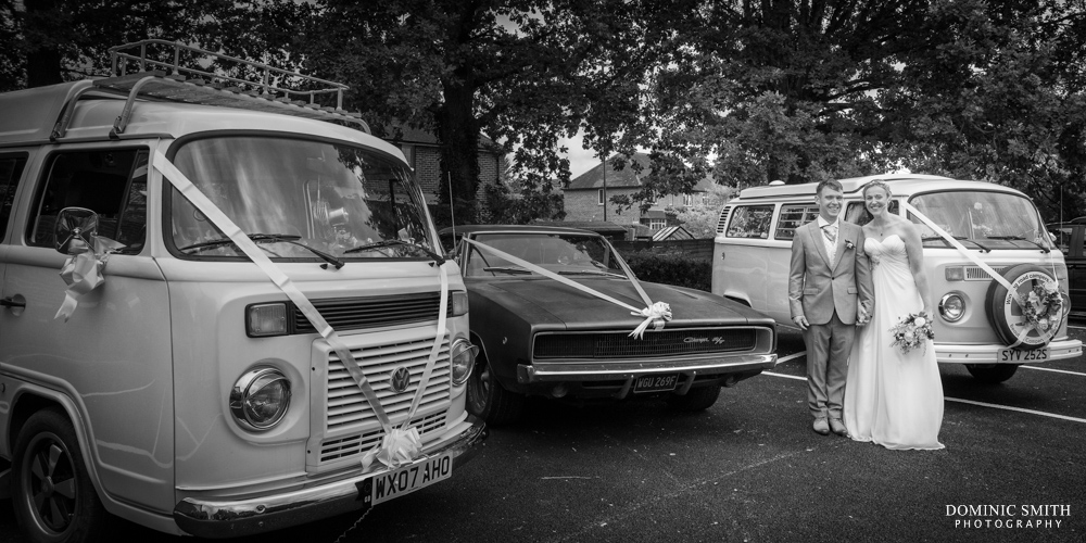 Bride and Groom with the wedding VW Campervans