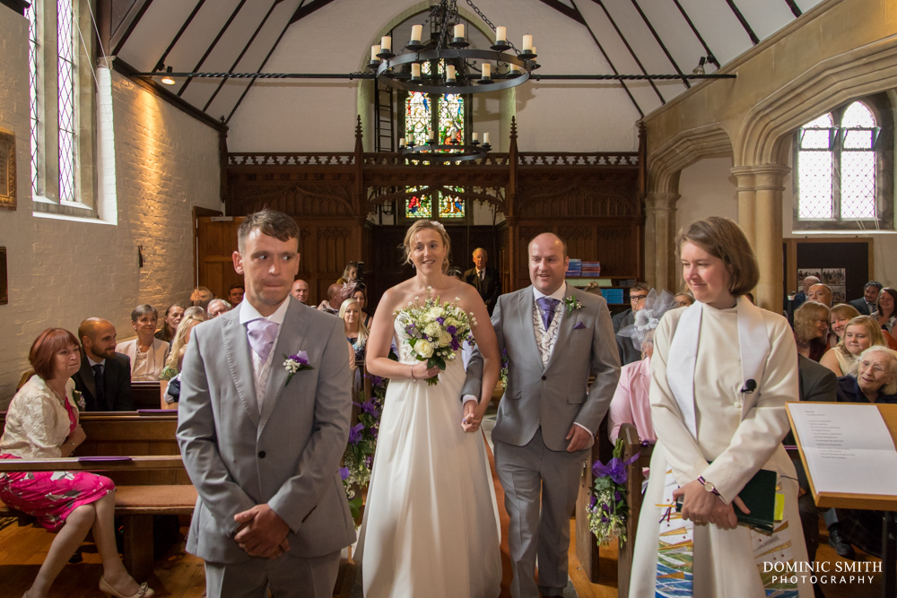 Bride walking down the aisle at St Augustines Church