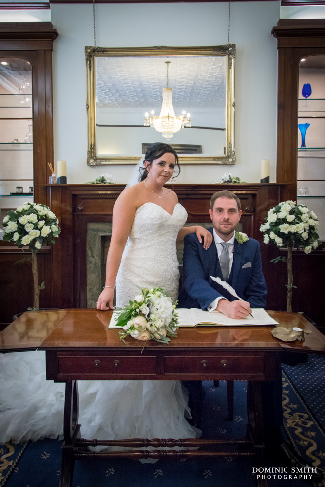 Signing the Register at The Mansion