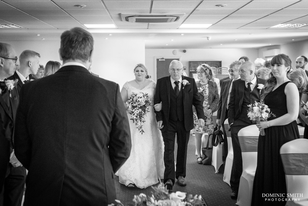 Bride walking down the aisle at Hickstead Hotel
