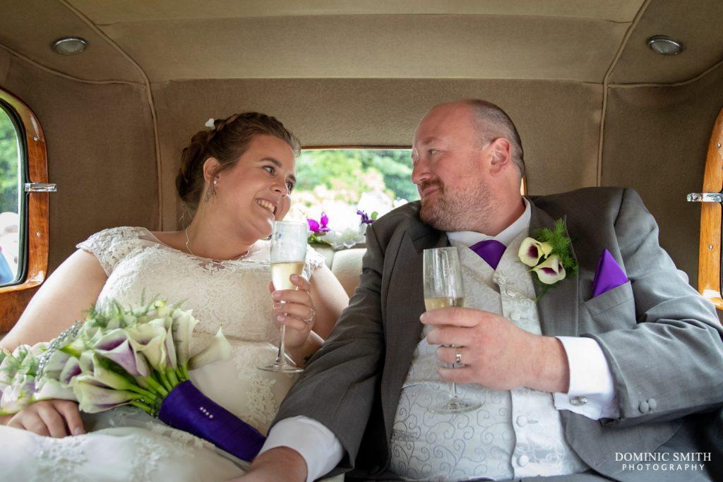 Bride and Groom in their Wedding Car