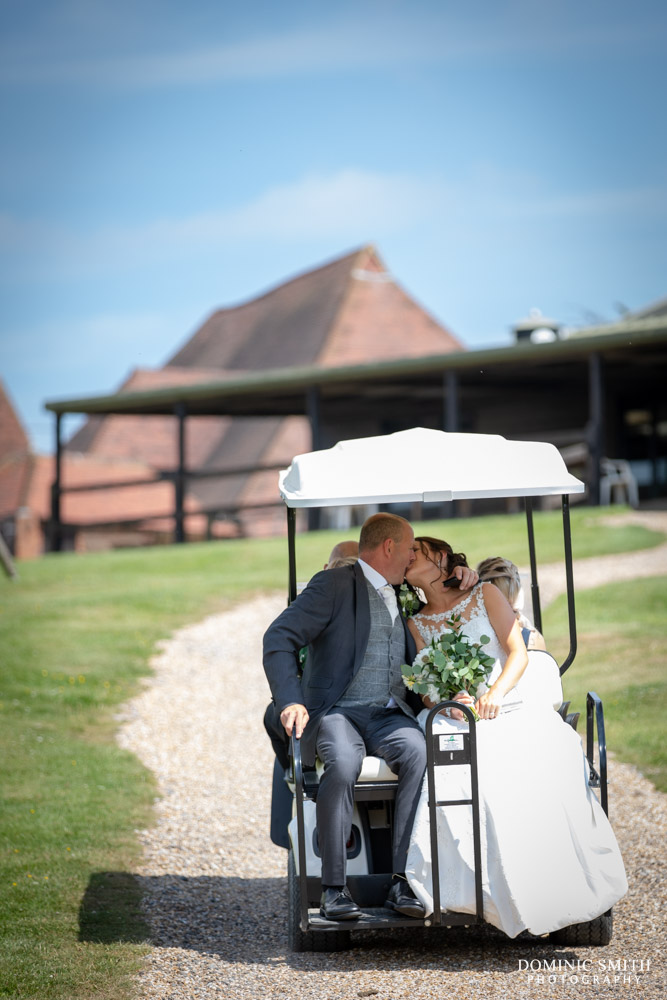 Bride and Groom riding the golf cart at Blackstock Country Estate