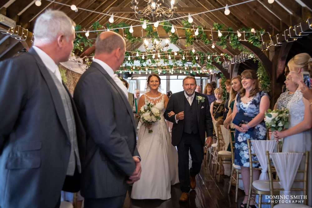 Bride coming down the aisle at Blackstock Country Estate