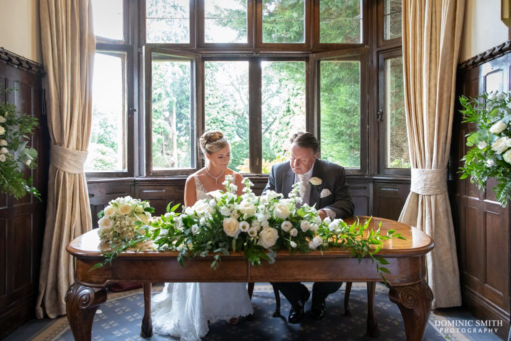 Signing the Register at Highley Manor