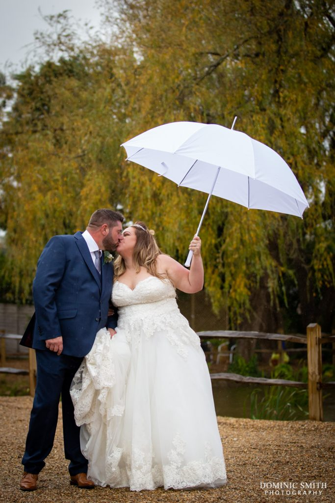 Couple photo under umbrellas at Random Hall