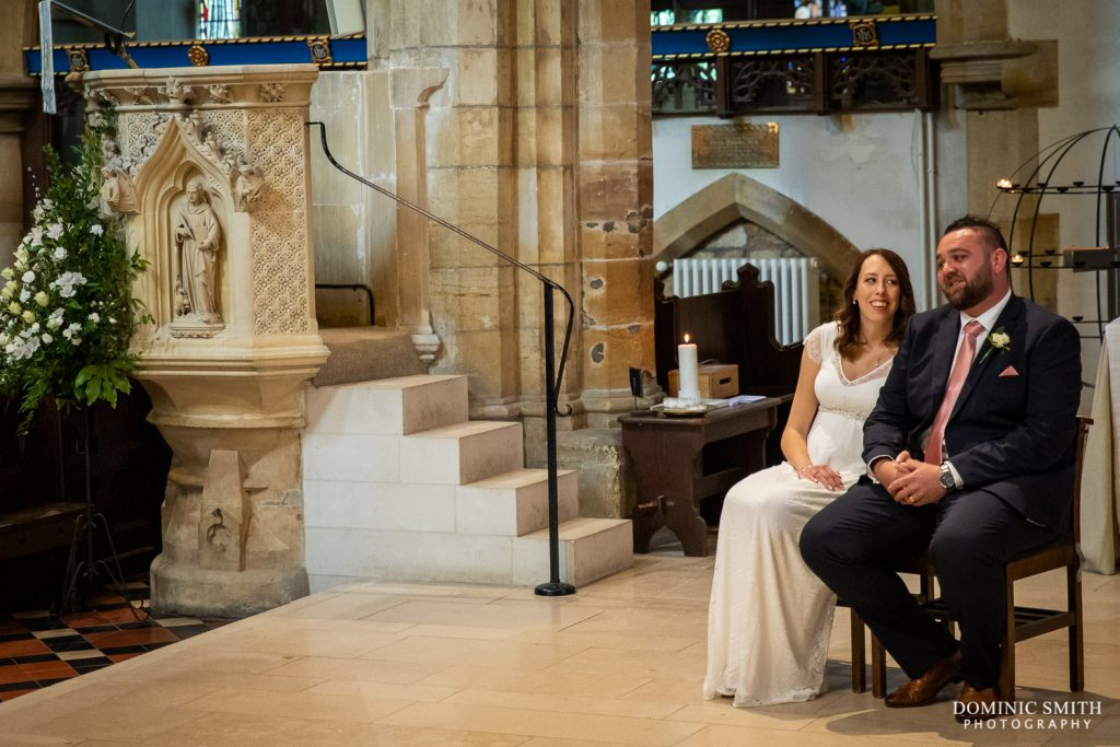 Bride and Groom during the ceremony at St Marys Church in Horsham