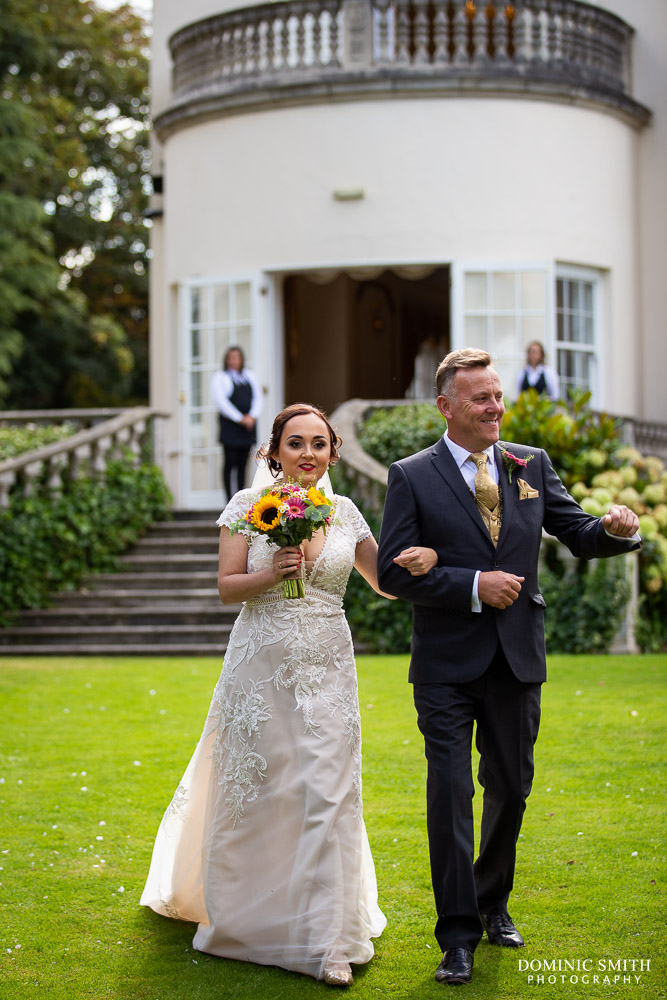 Walking down the aisle at Little Hermitage
